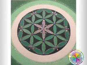 klasická piesková mandala kvet života v zelenej farbe na mandale